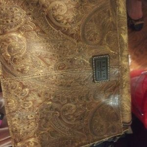 Relic patterned leather purse with brown pattern